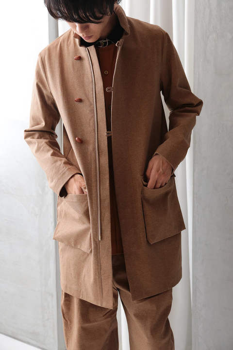 beige oily coat