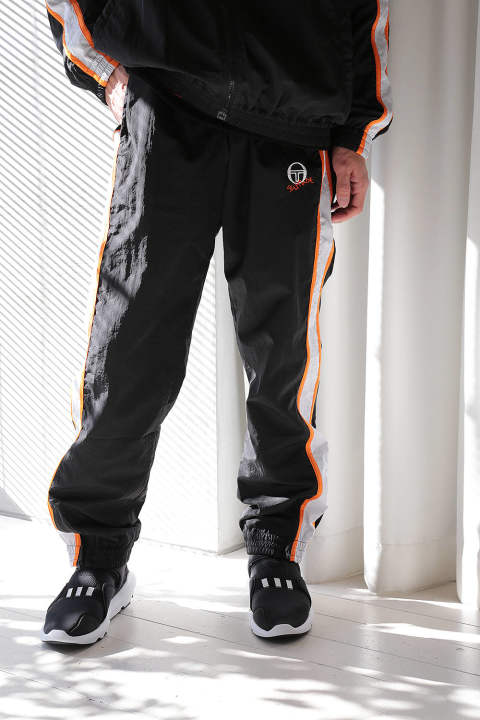 TRACKSUIT PANTS WITH STRIPED INSERTS AND EMBROIDERED LOGO ON THE FRONT(BLACK/WHITE/ORANGE)