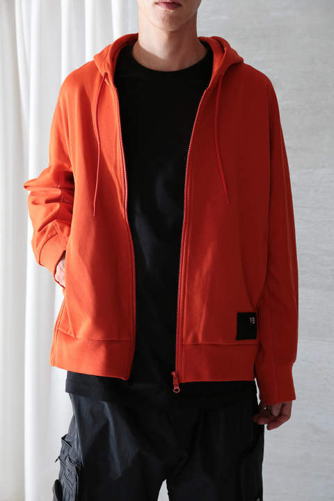 【ラスト1点】M STACKED BADGE FULL-ZIP HOODIE(ICON ORANGE)